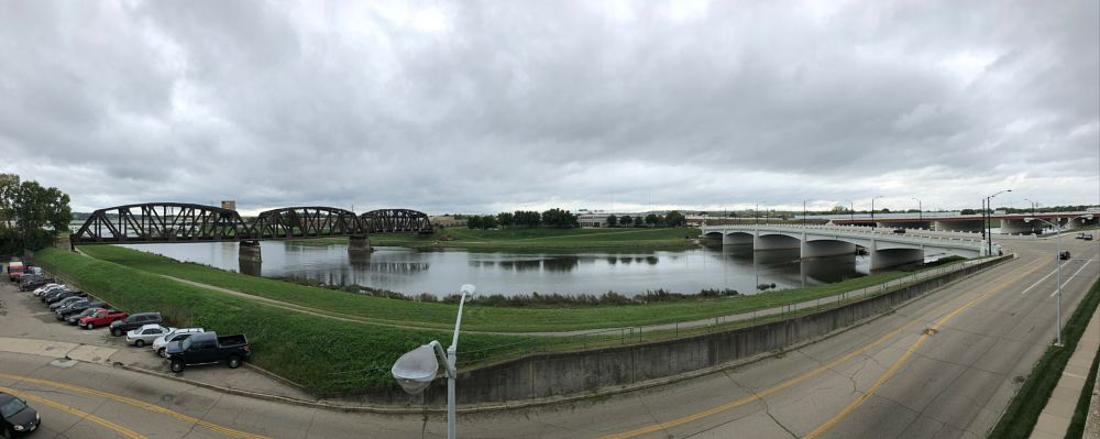 Photo in Random #panorama #dayton #ohio #color #photo #photography #photographer #color photography #river #train #bridge #bridges #art of visuals #aov #art of life #classy #classic #dapper #architecture #masterclass #photo #love #love life #a view to love for #blessed #photographer life #point of view #how did we end up here #cloudy skies #skies #mirroring #sunlight #shimmering #windy #wind blowing across the water #ripple effect #no editing