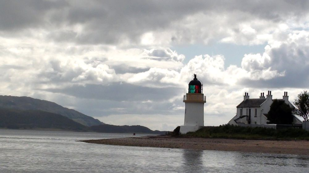 Photo in Landscape #lake #scotland #lighthouse #light #ships #boats #sky #clouds #grey #house #beach #sand #water #elements
