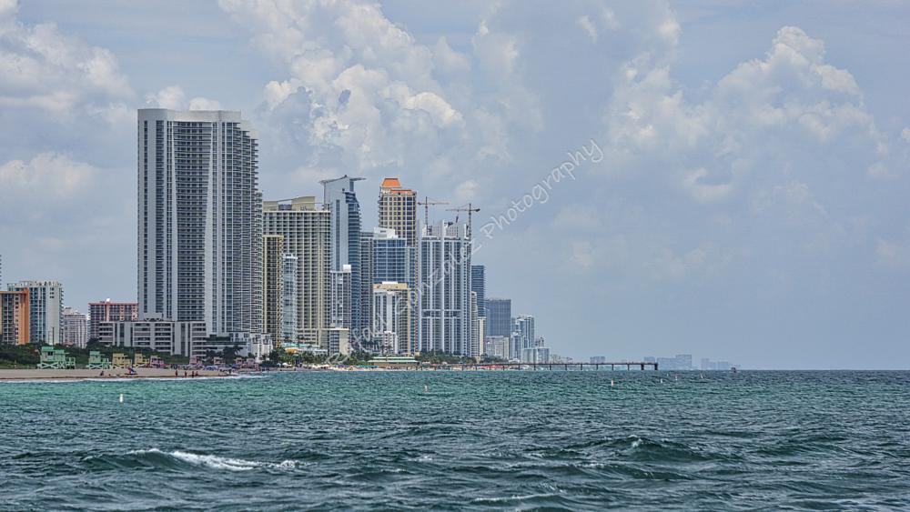Photo in Landscape #city #beach #sea #blue #sky #clouds #architecture #waves