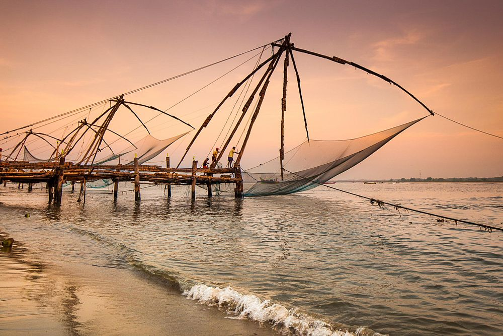 Photo in Travel #architecture #chinese fishing nets #culture #india #loctions #outdoor #sunset #daylight #fishermen #nets #sunrise #tradition #traditional boat #travel photography #unique fishing #warm colors
