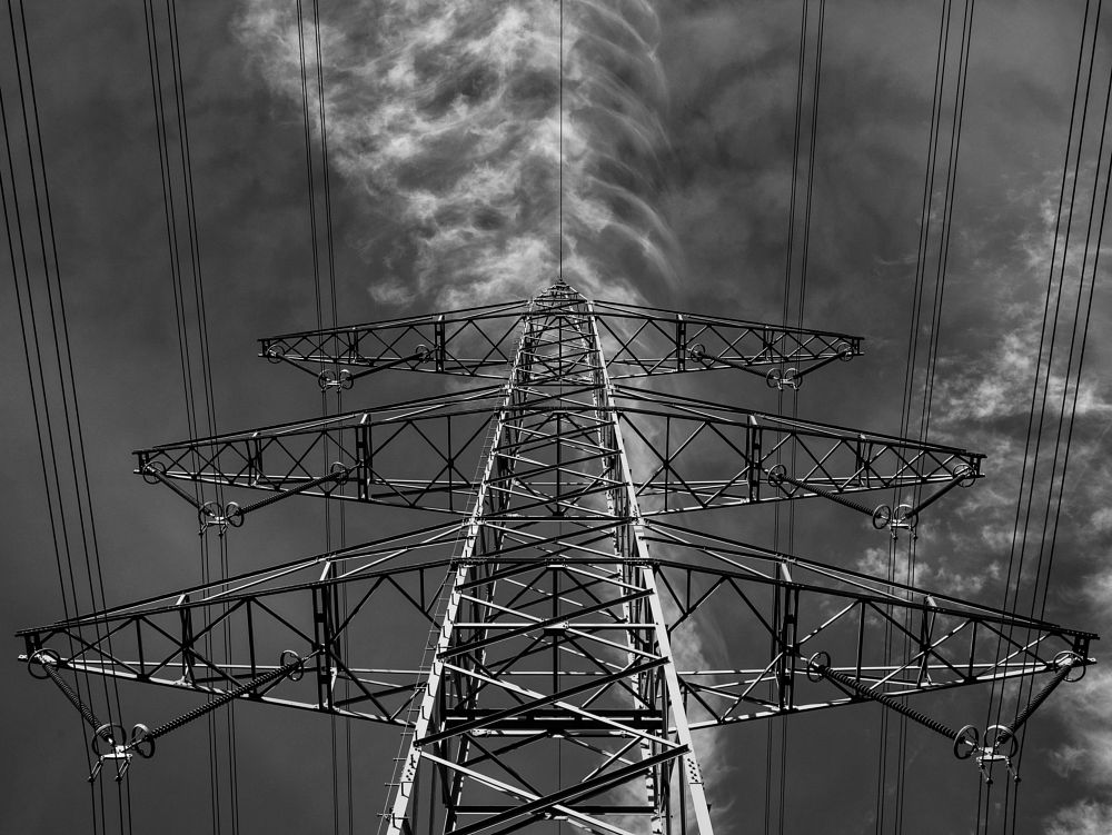Photo in Fine Art #powerpole #bnw #monochrome #fineart #clouds #metal #wires #lumix #panasonic #symmetry #black and white #structure