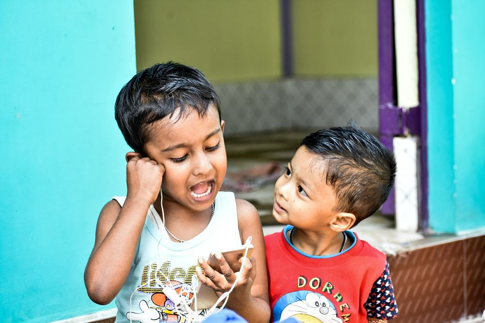 Photo in People #boy #boys #baby boy #people #human #asian #indian #assam #india #singing #listening #portrait #smile