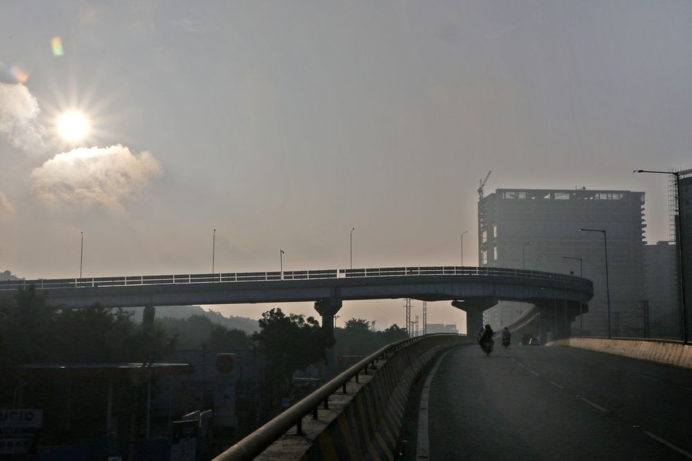 Photo in Cityscape #flyover #rising sun #buildings #passway #street photography