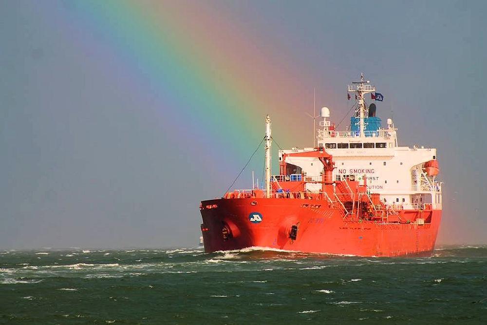 Photo in Landscape #rainbow #storm #ocean #boat