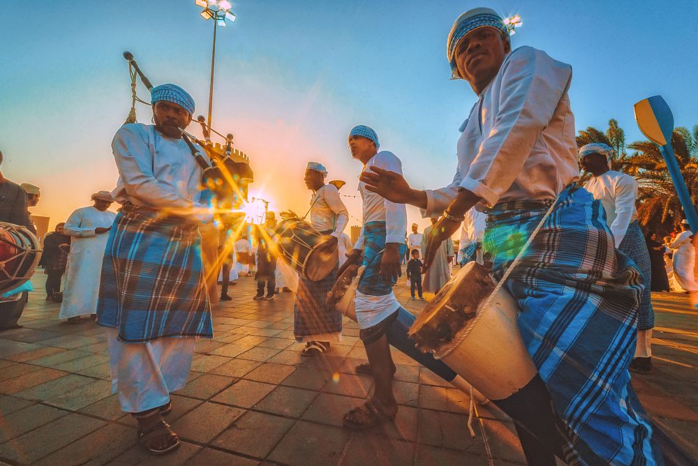Photo in People #omani #dance #drum #sunset #star #rays #sun #arab #muslim #festival #oman #sultanate #performance #culture #traditional