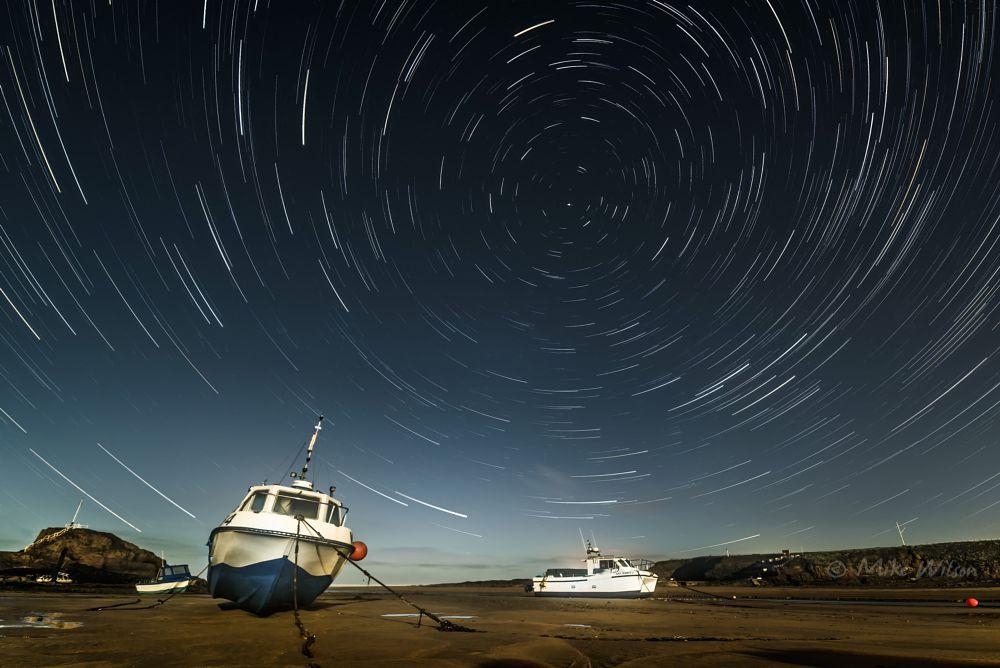 Photo in Random #star trails #stars #boats #harbour #sky #night sky #nightscape #night photography #beach #cornwall #bude