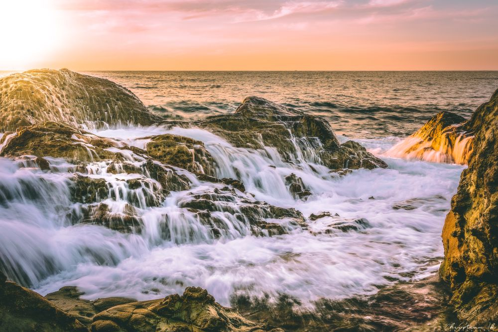 Photo in Landscape #sunset #sun #sea #seascape #ocean #nature #water #splash #wave #rock #light #long exposure #travel #calm