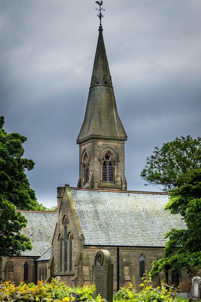 Photo in Architecture #spire #church #cloud #dark clouds #church yard #graves