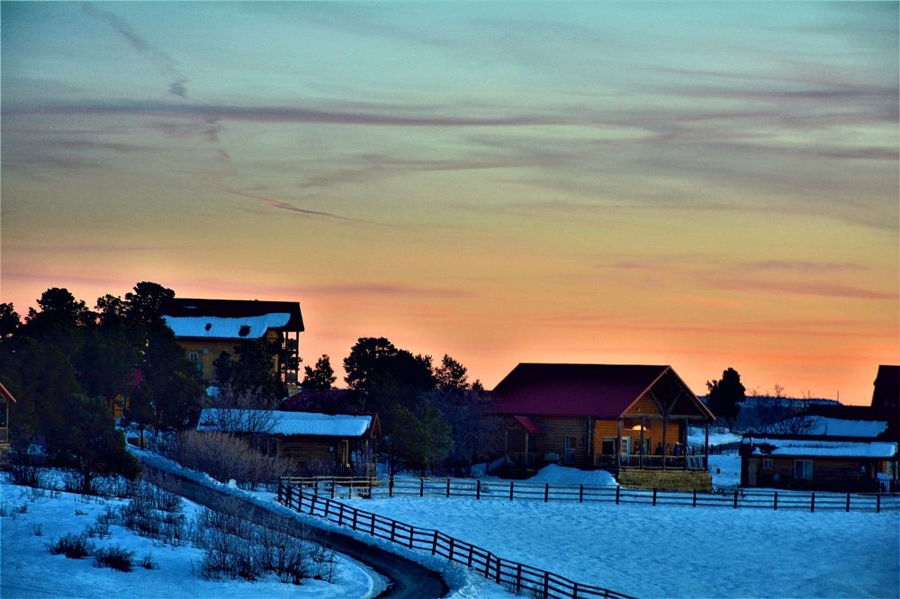Photo in Landscape #sunset #ranch #cabins #clouds #snow