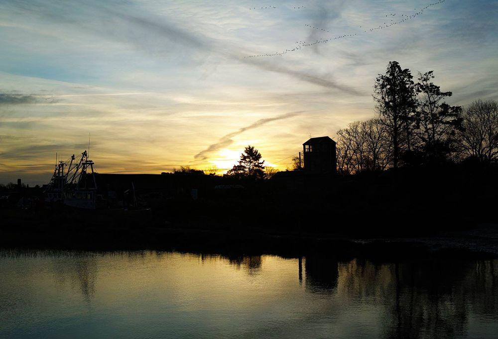 Photo in Landscape #landscape #sunrise #norfolk #silhouette #cloudscape #trees #port #building #boats #reflection