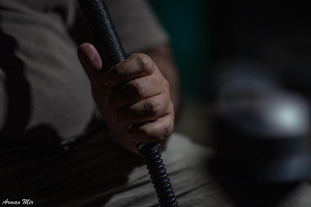 Photo in People #fist #fingers #thumb #hand #bokeh #low light #knuckles #shisha #sheesha #hookah #night #candid