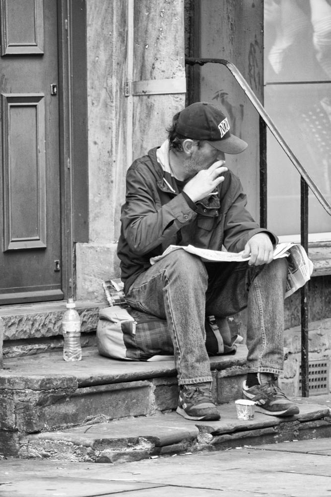 Photo in Black and White #manchester #stranger #change #beggar #homeless #newspaper #b&w #black and white #streetcontest