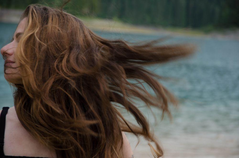 Photo in People #woman #portrait #wind #windy #hair #wind in hair #lake #in nature #beautiful