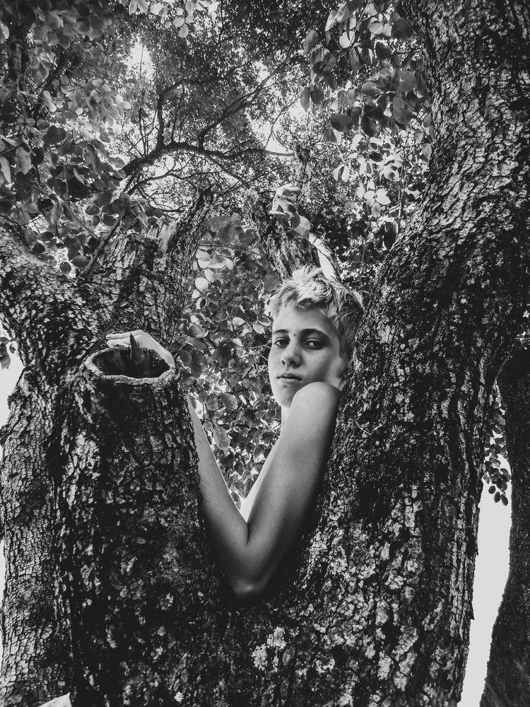 Photo in Black and White #boy #boyhood #child #childhood #child portrait #portrait #fine art #black and white #natural light #natural #nature #wild #dark #shadows