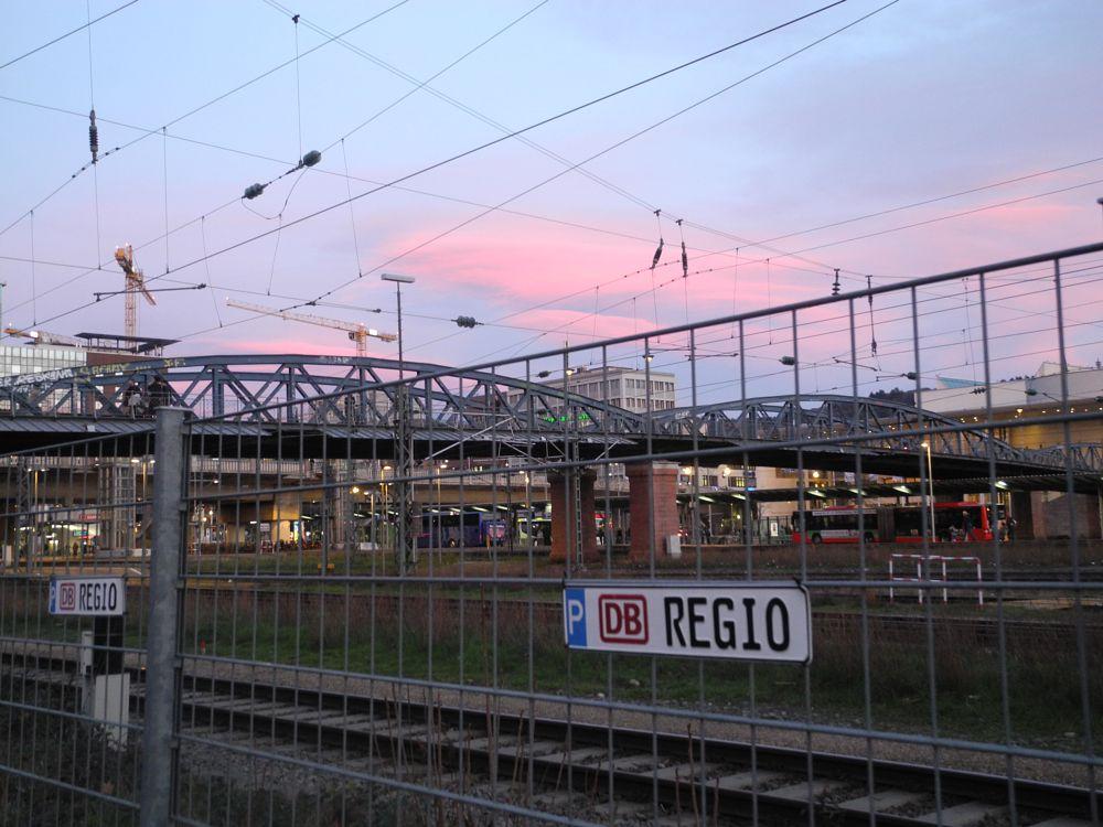 Photo in Fine Art #summer #evening #train station #bridge #fences #red bus #urban atmosphere #pink #cloud