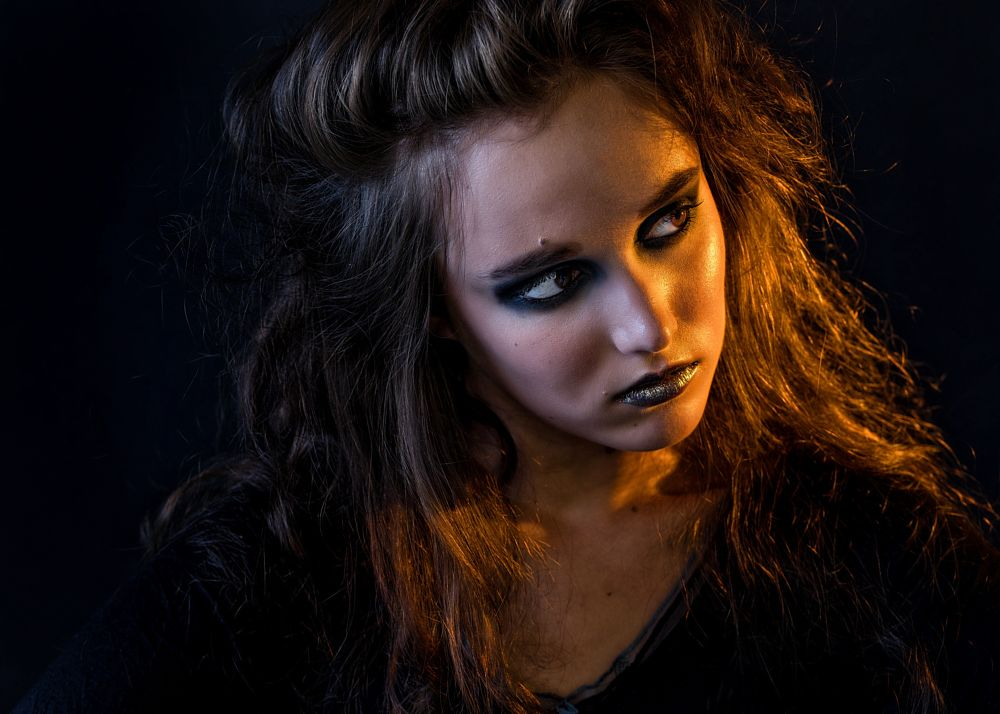 Photo in Fine Art #art #beauty #portrait #witch #black background #mixed lights #girl #strong face
