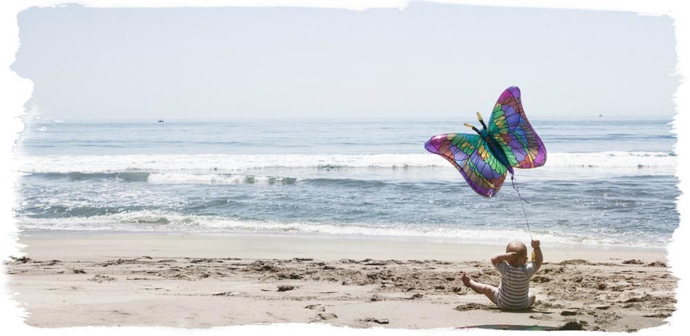 Photo in Portrait #beach #butterfly balloon #baby