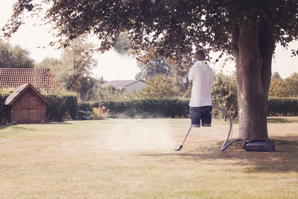 Photo in Random #guy #invisible #moon #field #houses #tree #vacuum cleaner #smoke