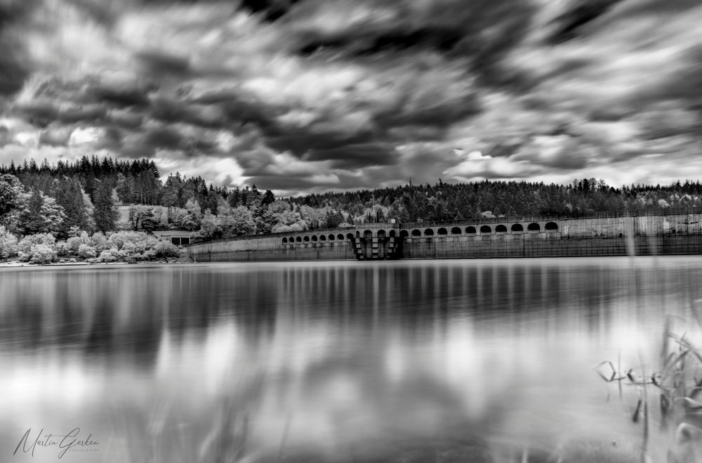 Photo in Black and White #damm #reservoir #wall #water #lake #reflection #monochrome #black and white #infrared #ir photography #720nm #schwarzenbach-talsperre #long exposure #cloud #clouds #dramatic sky