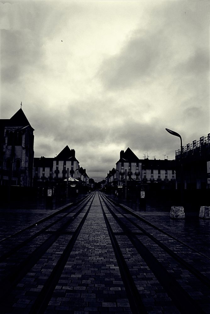 Photo in Street Photography #rail #street #tram lines #bw #b&w #black and white #monochrome #gray sky #tours #france #fujifilm #x-t2