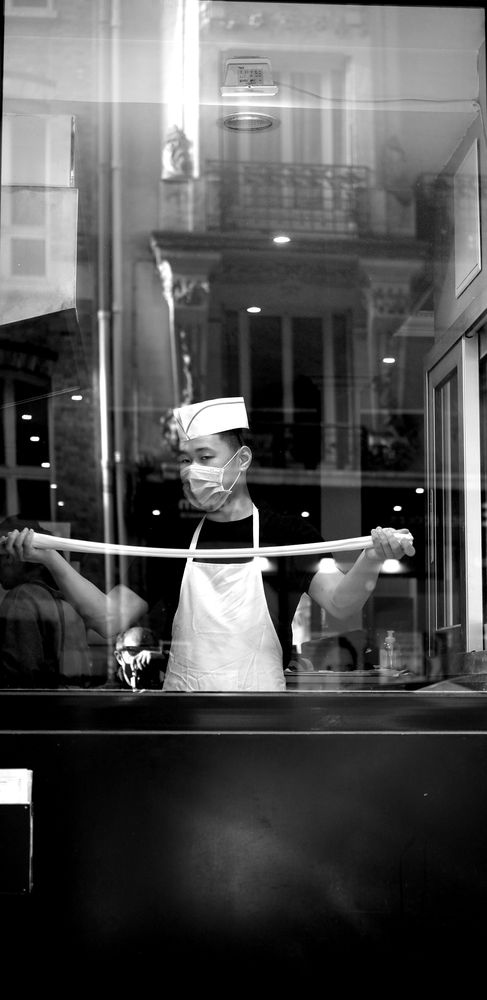 Photo in Street Photography #streetphotography #street photography #street #photographie de rue #bw #b&w #blackandwhite #black-and-white #chef #restaurant #noodles #city #urban #monochrome #fuji #fujifilm #x-t3