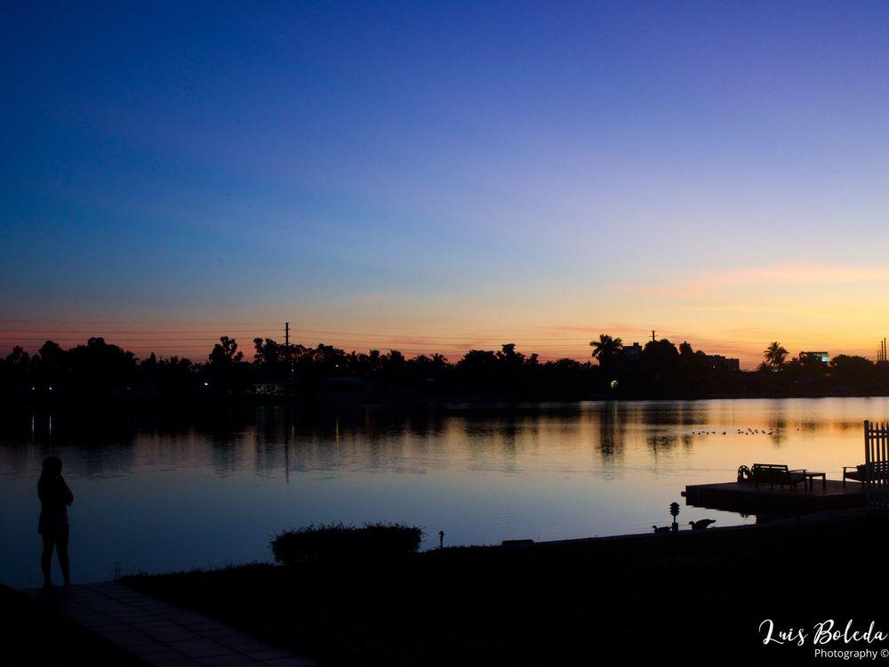 Photo in Nature #girl #ducks #lake #lakeshore #sunset #dawn #deck #floating deck #hialeah #florida #trees