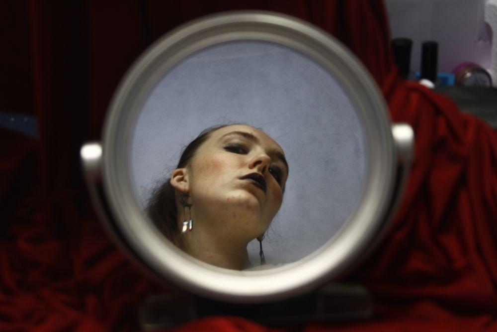 Photo in People with model Courtney Hayfield #dark #makeup #mirror #portrait #red #black #studio #earrings