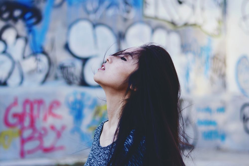 Photo in Portrait #girl #face #hair #sun #light #ny #city #urban #nyc #new york #nikon #50mm #wall #graffiti #people #portrait #model #actress #new yorker