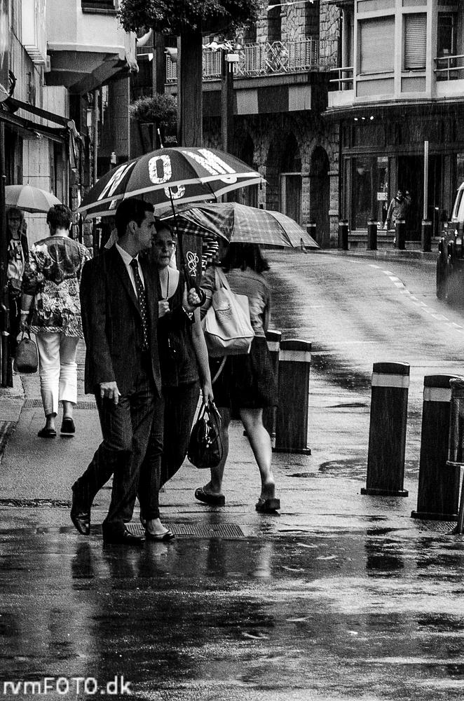 Photo in Street Photography #couple #rain #umbrella #rvmfoto.dk #street #b&w