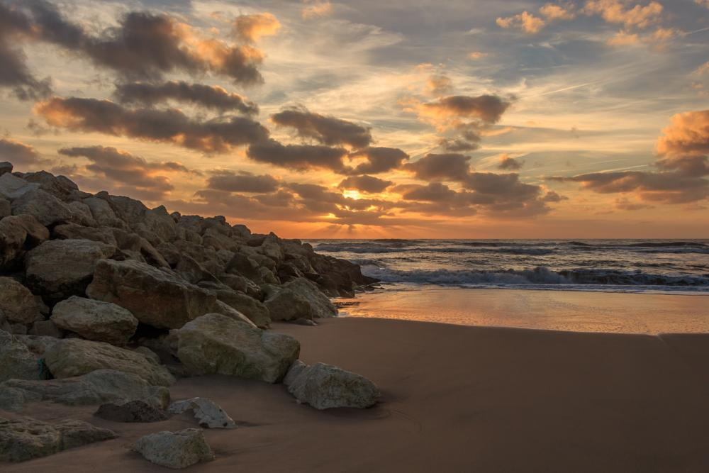 Photo in Landscape #sunset #beach #rocks #sand #sea #clouds #rays #sun