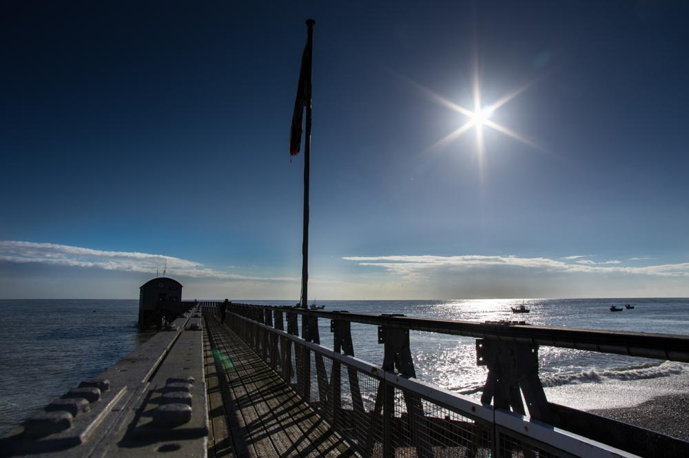 Photo in Sea and Sand #beach #bill #lifeboat #pier #sea #selsey #station #sun #water #waves #straight #lines #flag