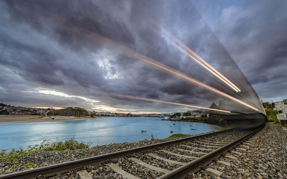 Photo in Landscape #train #coruña #madrid #renfe #sunrise #ria do burgo #barca #tren #nubes #clouds