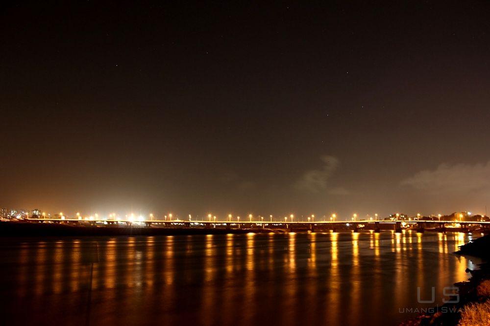 Photo in Random #longexposure #river #lights #stars #clouds
