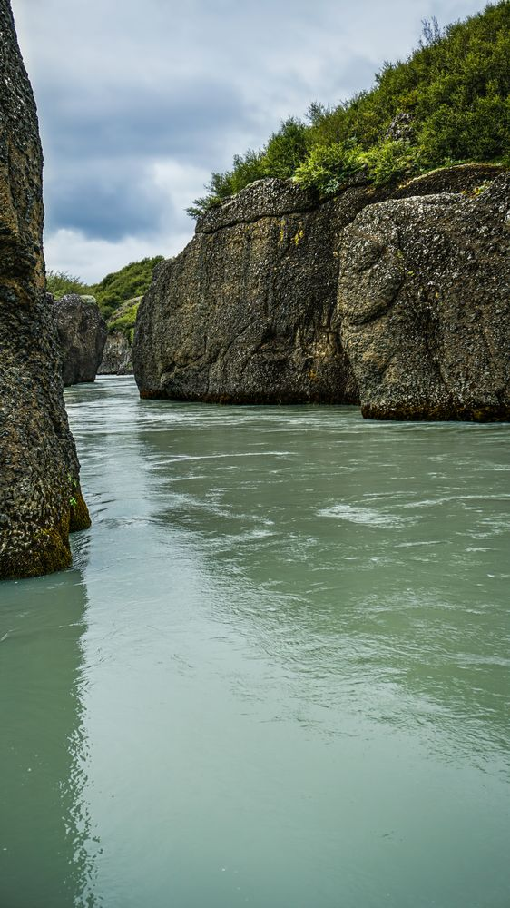 Photo in Landscape #iceland #murkywater #rocks #river #greenwater