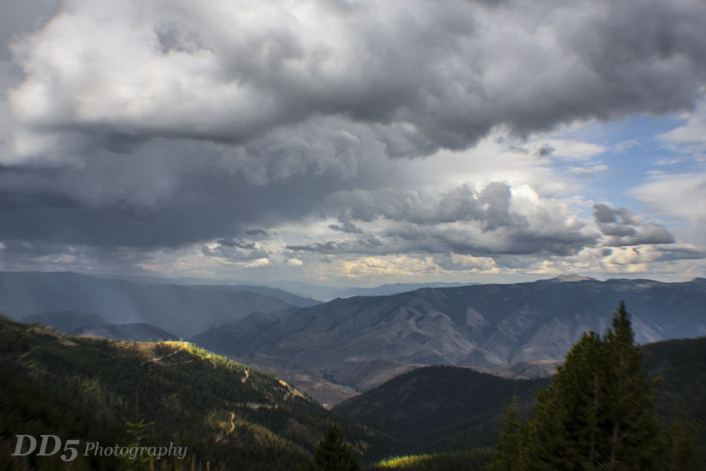 Photo in Landscape #idaho #mountains #storm #sunbeams #sun beams #light #clouds #valley