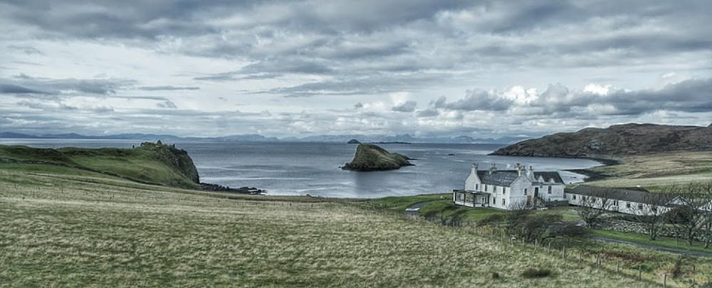 Photo in Landscape #skye #island #view #scotland #hebridese #sea #cottage #clouds #fields #trees