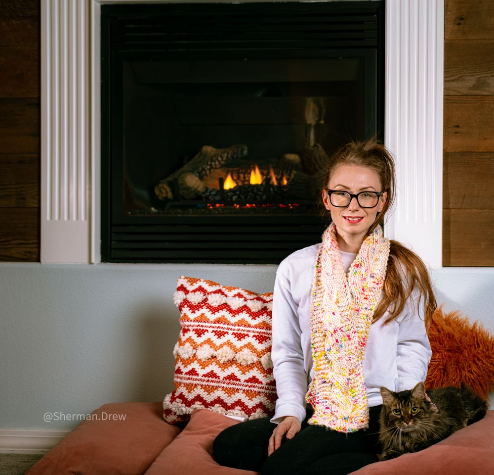 Photo in Random with model Jamie Waclawik #cats #animals #knitting #colors #fire #red head #kitty #pillows #wood #fireplace #fall #arange #jamie