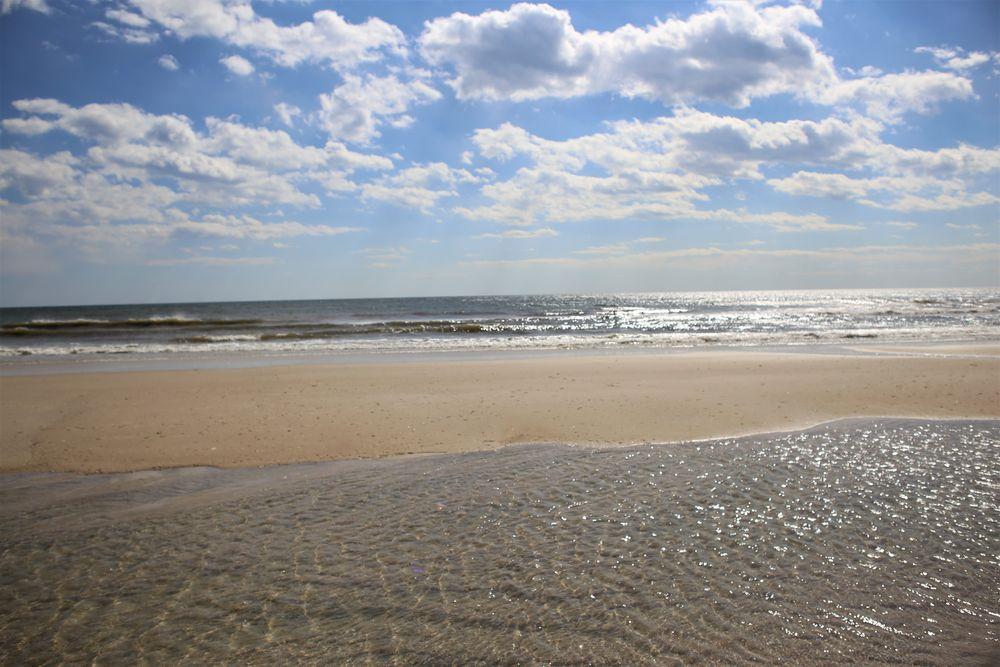 Photo in Random #fire island #island #water #ocean #sand #ny #new york #sunny #round #holes