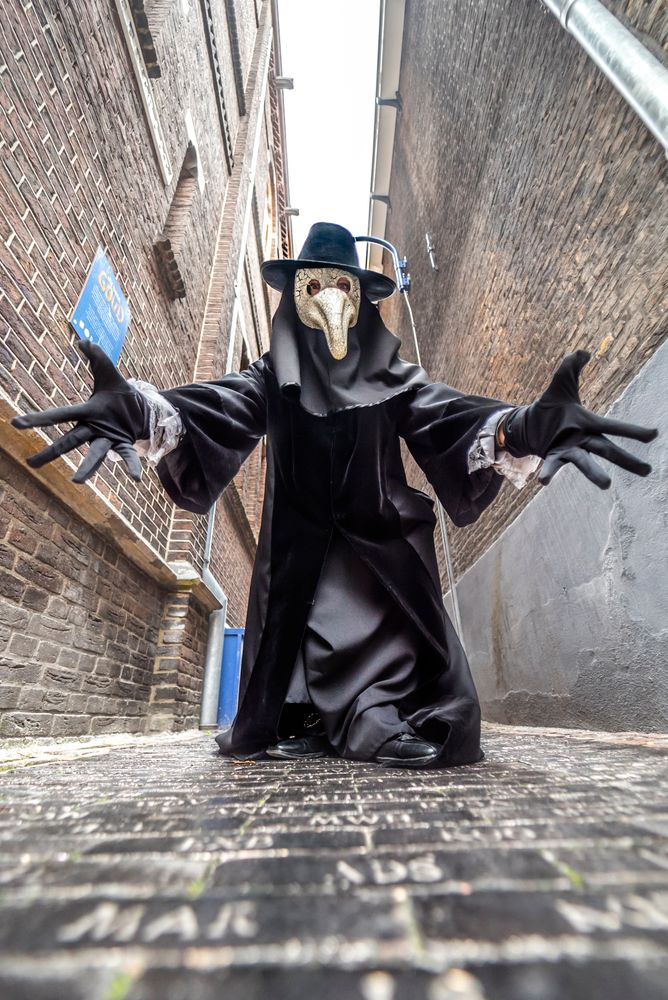Photo in Random #the plague doctor #alley #black #medieval #delft #old town #golden tiles
