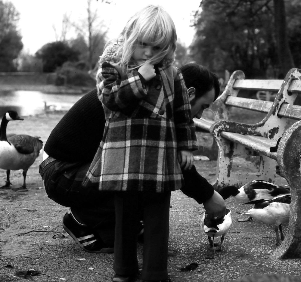 Photo in Black and White #girl #ducks #park #people