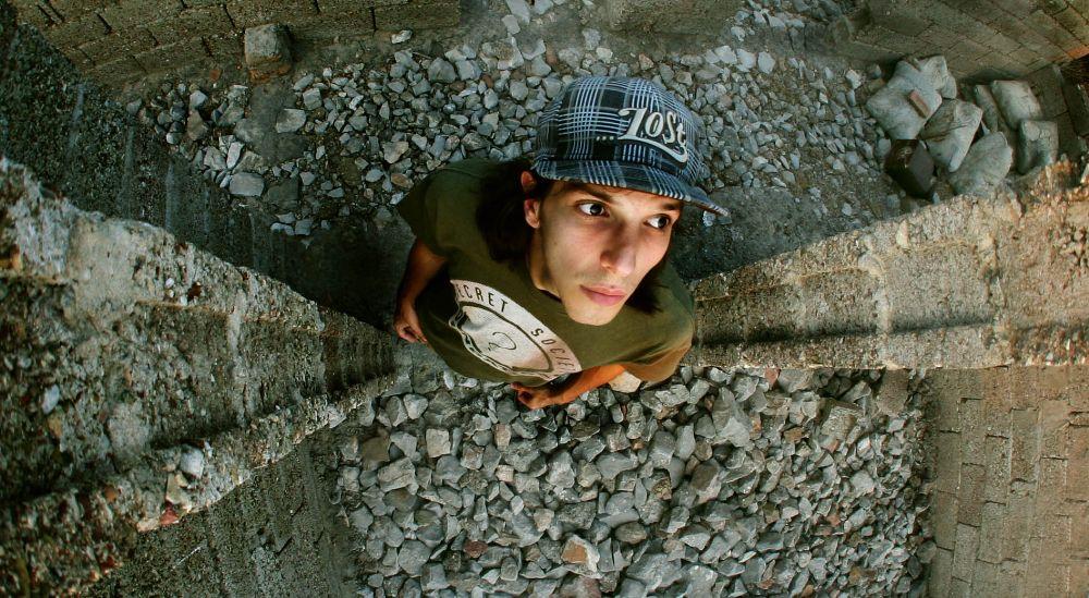 Photo in Fashion #man #portrait #stones #urban decay #fashion #lost #hat #male #male model
