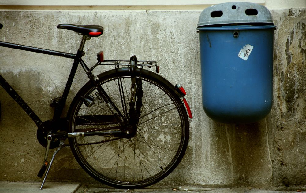 Photo in Street Photography #bicycle #still life #wall #wastebox #waste