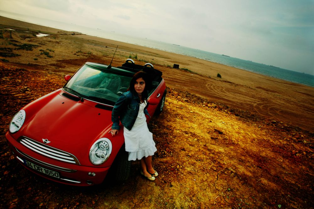 Photo in People #mini #car #red #red car #shore #seaside #beautiful #woman #beauty #cabrio #spil