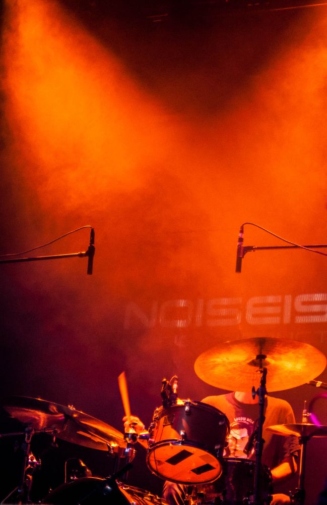Photo in Concert #drums #drum set #concert #orange #ambient light #drummer #music #roc music