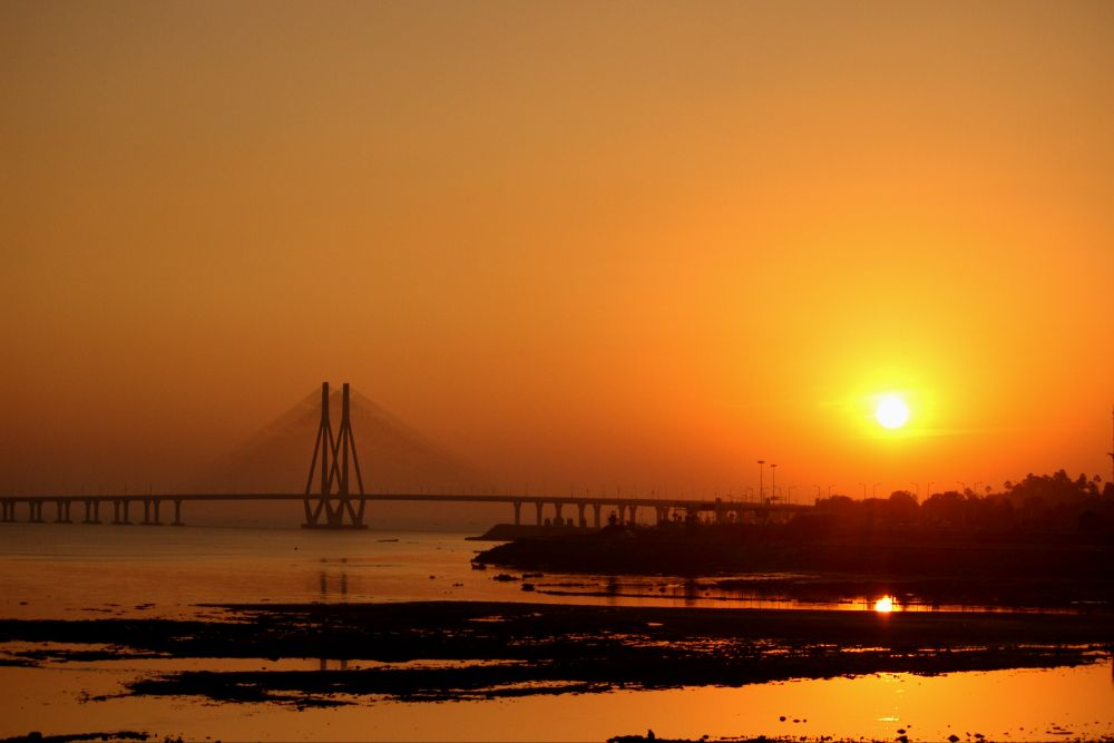 Photo in Landscape #sunset #mumbai #arabian sea #sea #sealink #worli #bandra #bridge #sun #sky #golden