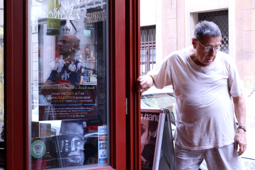 Photo in People #people #budapest #street #cafe #door #red #travel #glass
