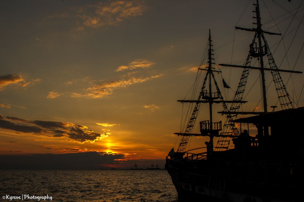 Photo in Travel #boat #silhouette #sky #clouds #sunset #sea #sails