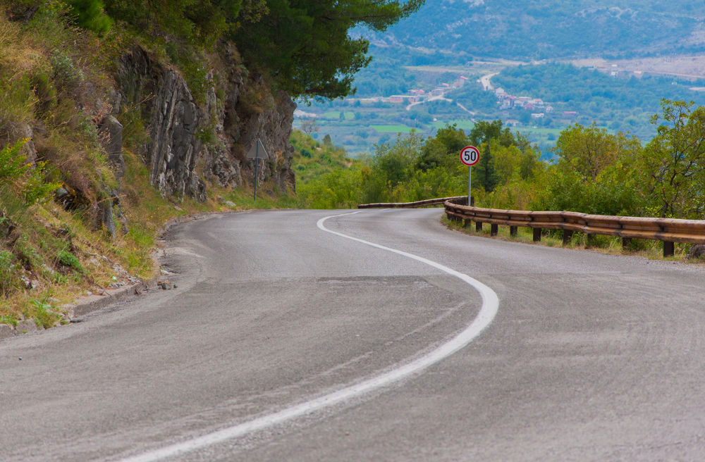 Photo in Landscape #road #twists #nature #trees #asphalt #sign #rocks #drive