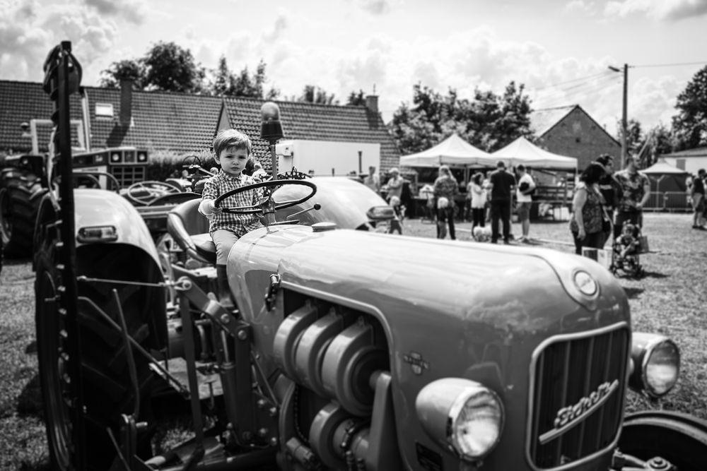 Photo in Black and White #boy #tractor #arquennes #belgium #countryside #leica #leicaq #monochrome #blackandwhite #bnw #photoeveryday