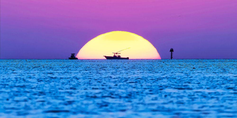 Photo in Landscape #sunset #florida #sun #boats #gulf of mexico #florida bay #blue #purple #felipe #correa #blush #dusk #sunboating #narrow angle